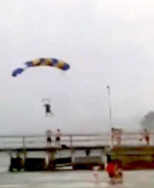 Sky divers on descent before being rescued after wild storms hit St Kilda on Wednesday.
