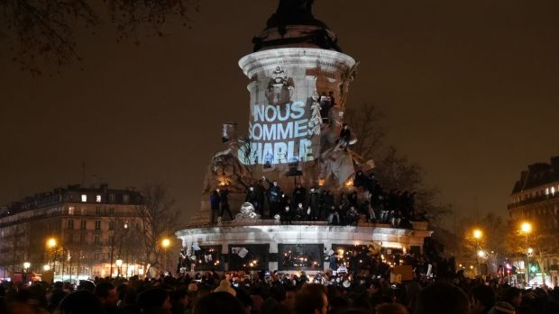 Crowds gather at the Place de la Republique in Paris to protest against the killing of <i>Charlie Hebdo</i> magazine ...