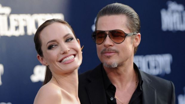 Friends in high places: Angelina Jolie and Brad Pitt have arranged to meet with Pope Francis at the Vatican.