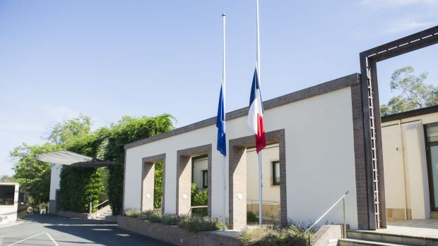 In shock: Flags at the French embassy at Yarralumla fly at half mast on Thursday morning.
