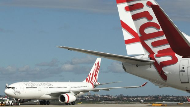 Virgin Australia said it narrowed its first-half statutory net loss.