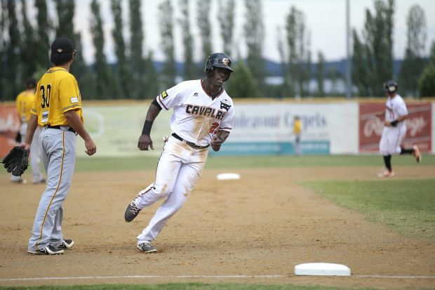 Canberra's Anthony Alford rounds third base to get his second run for the game.