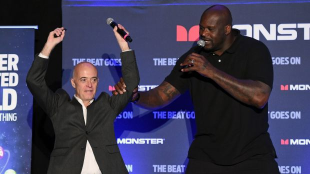 Shaquille O'Neal on stage with Monster's Vern Smith.
