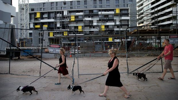 Zetland residents walk past a Green Square development earlier this year.