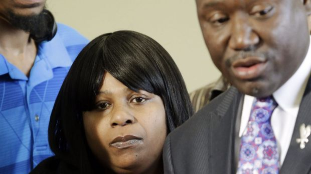 Family: Samaria Rice listens to her lawyer at a news conference held after the shooting of her son, Tamir.