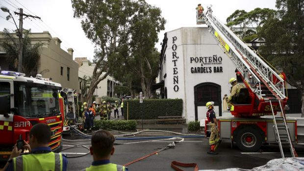 Firefighters extinguishing the blaze at Porteno, 2015.