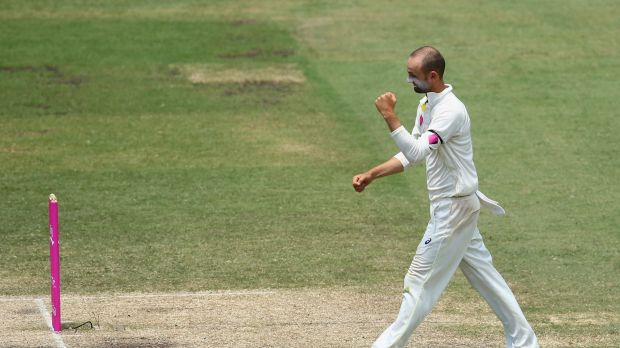 Turning opinion: Nathan Lyon celebrates the wicket of Bhuvneshwar Kumar in the first innings.