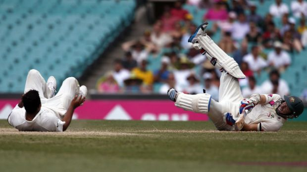 The fall guys: Chris Rogers, right, lies on the ground after colliding with India's Suresh Raina on Friday.