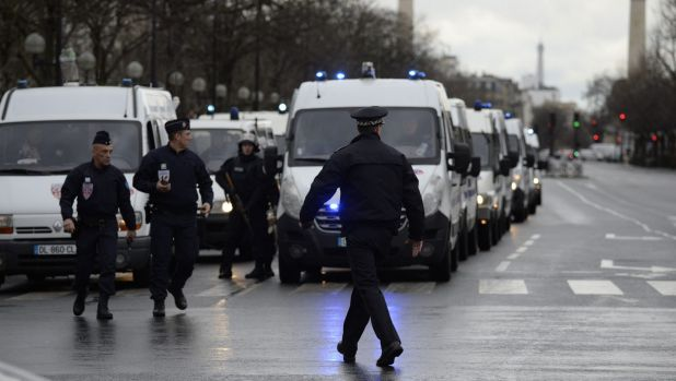 Police gather together at the Porte de Vincennes, east Paris, as they work to surround the grocery store.
