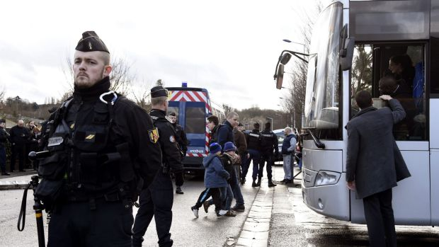 French gendarmes stand by as children are evacuted from a school in Dammartin-en-Goele, north-east of Paris.