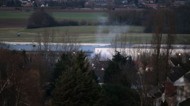 Smoke rises from a building in Dammartin-en-Goele, north-east of Paris, where two brothers suspected of killing 12 ...