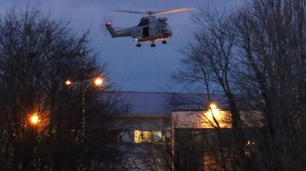 A helicopter hovers after the final assault at the scene of a hostage taking at an industrial zone in ...