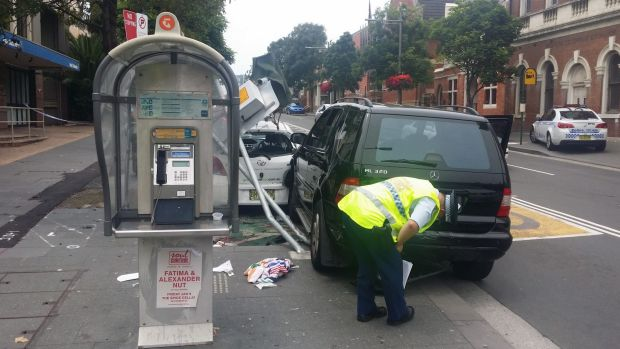 The victim was pinned to the speed camera pole in Redfern, witnesses say.