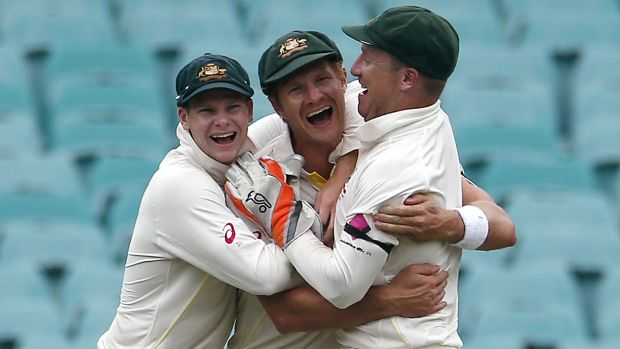 Shane Watson is embraced by Steve Smith and Brad Haddin after catching Virat Kohli.