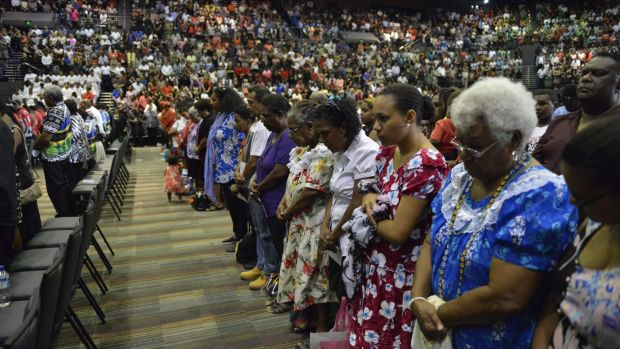 Mourners fill Cairns Convention Centre.