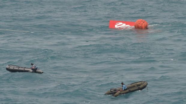 Part of the tail of AirAsia flight QZ8501 floats on the water's surface on Saturday.