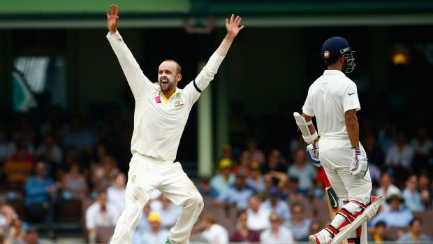 Appealing: Nathan Lyon appeals for the wicket of Wriddhiman Saha.