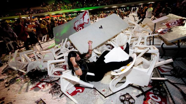 Elements of the crowd at Darts Invitational Challenge trashed chairs and tables.