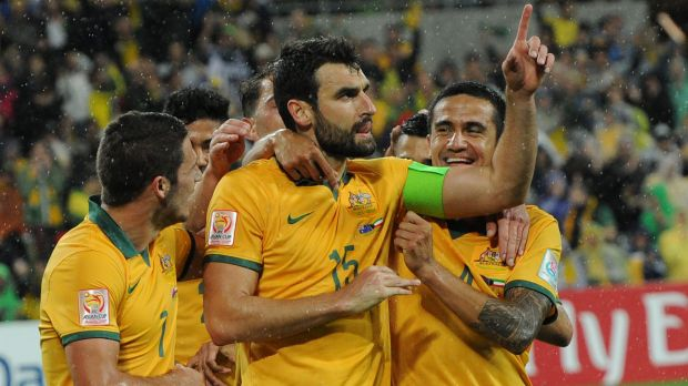On the up: Mile Jedinak (centre) is rested and ready.