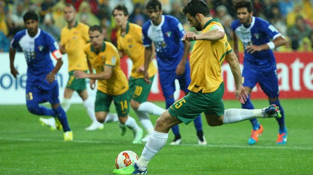 Positive start: Mile Jedinak winds up from the penalty spot to extend the Socceroos' lead against Kuwait in the Asian ...