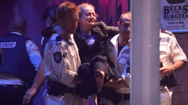 Marcia Mikhael is rescued from the Lindt cafe in Martin Place in Sydney. She is reportedly receiving $400,000 for a ...