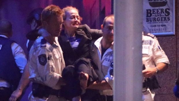 Marcia Mikhael being rescued from the Lindt cafe in Martin Place in Sydney.