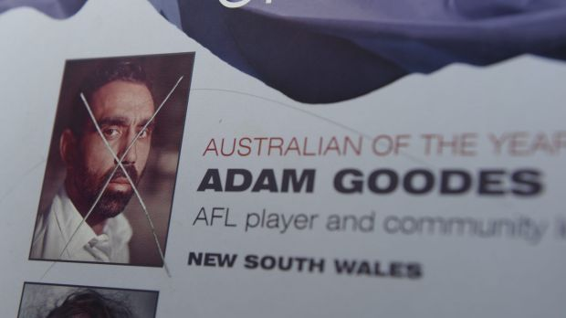 The damaged plaque, on the shores of Lake Burley Griffin, displaying the image of Adam Goodes, Australian of the Year 2014.