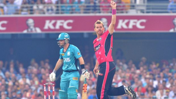 Not done yet: Brett Lee of the Sixers takes the wicket of James Peirson.