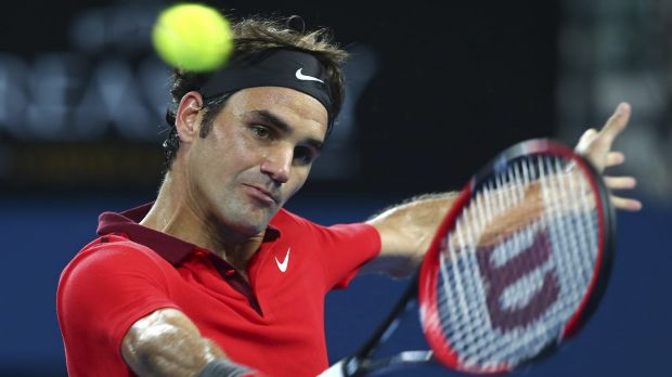 Roger Federer plays a backhand against Milos Raonic in the final of the Brisbane International on Sunday.