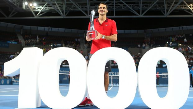 Twin peaks: Roger Federer holds his first Brisbane International trophy, achieved in his 1000th career match win.