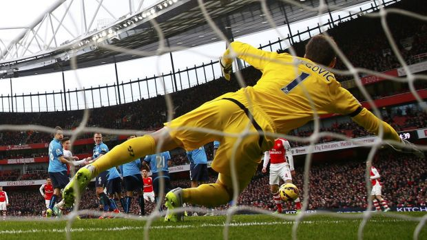 Stoke goalkeeper Asmir Begovic can't keep an Alexis Sanchez free kick out at the Emirates on Sunday.