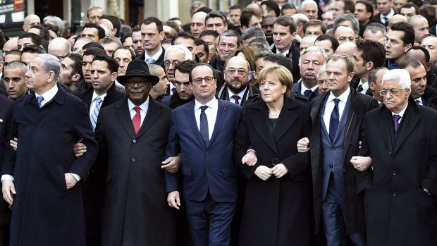 United front or hypocritical? World leaders walk arm-in-arm at the head of the Paris march on Sunday.