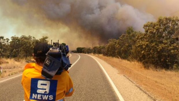 A Nine News cameraman captures vision of the Bullsbrook blaze.