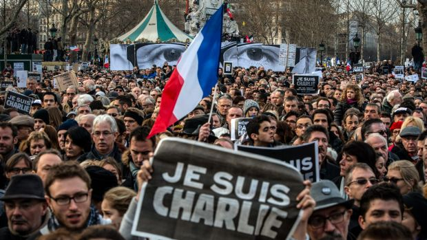 Thousands gather in Paris for a solidarity march with victims of the Charlie Hebdo massacre. The attack has sparked new ...