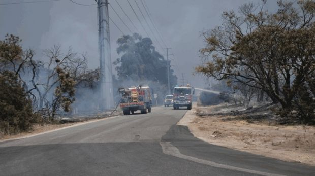Firefighters battle a large bushfire in Bullsbrook.