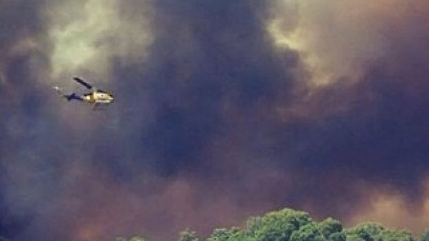 A firefighting helicopter helps battle the Bullsbrook blaze.