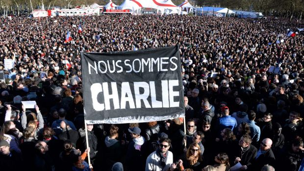 """People hold a banner reading in French """"We are Charlie"""" during a march in Bordeaux."""