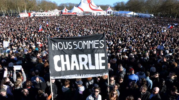"People hold a banner reading in French ""We are Charlie"" during a march in Bordeax, south-western France."