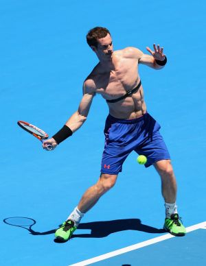 Upbeat: Andy Murray gets in some tough practice for the Australian Open on Monday at the Rod Laver Arena.