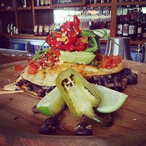 Most moreish: The coconut and black bean quesadilla come with a fresh tomato salsa. avocado and lime.