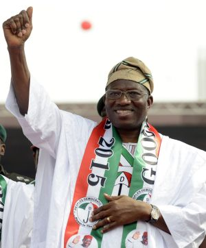 Struggling to face Boko Haram ... Nigerian President Goodluck Jonathan waves to supporters during a rally in Lago on ...