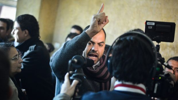 """Family members react in a Cairo court following the acquittal of 26 male defendants accused of """"debauchery""""."""