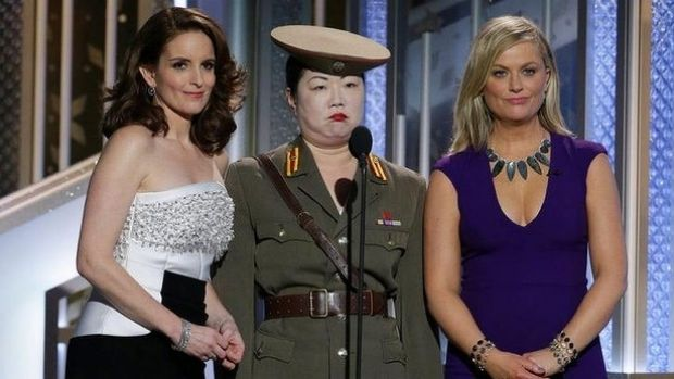 Tiny Fey, from left, Margaret Cho, and Amy Poehler make gags at North Korea's expense at the 72nd Annual Golden Globe ...