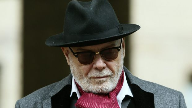 Former British pop star Gary Glitter leaves Southwark Crown Court in London on Monday.