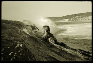 Surf's up: <i>Nigel Coates and Murray Smith, Smiths Beach, WA</i>, 1972, by John Witzig. Pigment print. Collection of ...