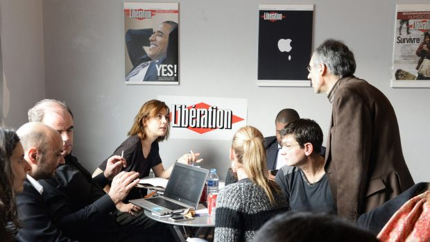 Editorial staff of French satirical newspaper <i>Charlie Hebdo</i> and <i>Liberation</i> gather.