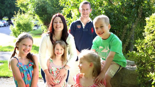 Michele Markham with husband Chris and their children (left to right) Emily (9), Katie (5), Sophie (5), and Mike (7).
