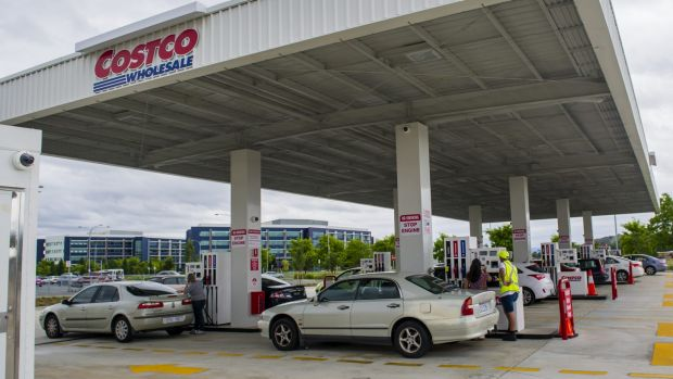 Canberra motorists get in for their cheap fuel at Costco Majura Park on Tuesday afternoon.