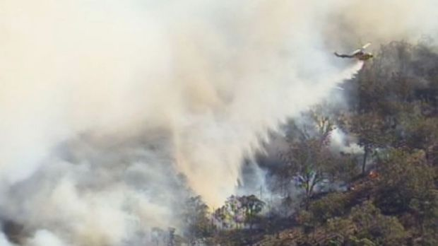 A helicopter helps fight the fire in West Toodyay.