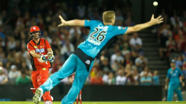 The Heat's Andrew Flintoff fails to effect a catch as Tom Beaton of the Renegades plays a lofted stroke.